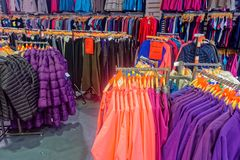 A display of men`s and women's outdoor clothing. Stock Photo
