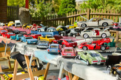 A display of model cars for sale on a trestle table Royalty Free Stock Images
