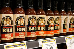 Display Newmans bbq sauce. Inside buy low foods store royalty free stock image