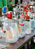 A display of  old antique glass  butter churns Royalty Free Stock Image