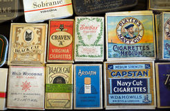 Display of Old Cigarette Packets. Waterbeach, Cambridgeshire, England - August 03, 2014: Display of Old Cigarette Packets from the 1940s Royalty Free Stock Images