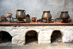 Display of old earthenware and iron cooking pots Stock Images