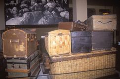 Display of old trunks and suitcases at Ellis Island National Park, New York City, New York Royalty Free Stock Photo