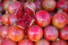 Pomegranate for sale on market. Display of opened up red pomegranates on  market Royalty Free Stock Image