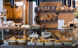 Display of ordinary bakery with bread and buns Royalty Free Stock Photography
