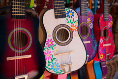 Display of ornate, small Mexican made guitars stock image