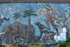 Display at a paleontology museum. Bas relief wall at a paleontology museum in Bolivar, Ecuador stock image