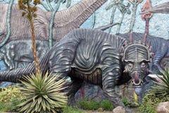 Display at a paleontology museum. Statue of an ice age hunting scene at a paleontology museum in Bolivar, Ecuador stock photos