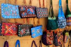 Display of Purses and Handbags. Colorful, hand embroidered purses and handbags displayed at Patawon-ki-Haweli, Jaisalmer Fort, Jaisalmer, Rajasthan, India, Asia Royalty Free Stock Photos