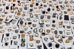 Display with Rings -. Exhibitor in market with different designs plated rings and colored stones Royalty Free Stock Images