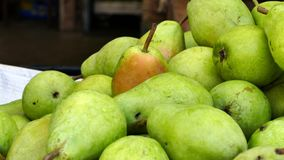Display of Ripe Organic Pears at a Farmers` Market stock photo