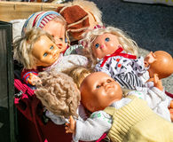 Display of 70s second hand plastic dolls for reusing toys Stock Images