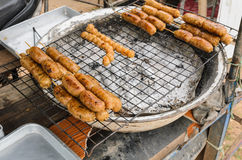 Display for sell BBQ with fiery sausages Stock Photos