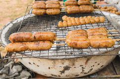 Display for sell BBQ with fiery sausages on grill Stock Image