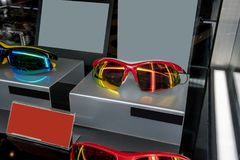 Display in store with different sun glasses eyewear models stock images