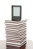 Display tablet over stack of books Stock Photos