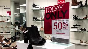 Display today only fifty percent off on sale. Inside The bay store stock video