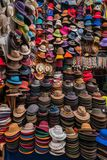 Display of traditional colorful Peruvian hats. Display of traditional colorful handmade Peruvian hats on a stall at the market in a full frame view royalty free stock photos