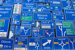 Display of the traffic signs at the exterior wall of the Swiss Museum of Transport in Lucerne, Switzerland. Stock Photos