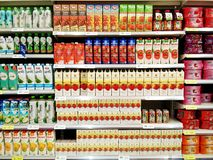 Display of variety healthy fruit juice on shelf. Bangkok, Thailand - June 14,2019 : Display of variety healthy fruit juice on shelf for selling at Tesco Lotus royalty free stock image