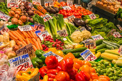 Display Variety Vegetables in Market. A close up view of a colorful display of a large variety of fresh vegetables with handmade signs identifying their names Royalty Free Stock Image