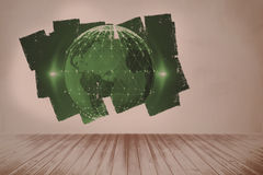 Display on wall showing global technology graphic. In grey room Royalty Free Stock Photo