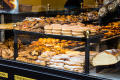 Display window of a bakery and pastry shop in Maisonnave Avenue of Alicante, assortment Stock Photos
