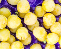 Display of yellow plums at the market Stock Photography