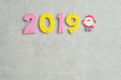 2019 displayed with a Santa Clause figurine. On a white background Royalty Free Stock Photo