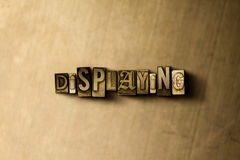 DISPLAYING - close-up of grungy vintage typeset word on metal backdrop Stock Image