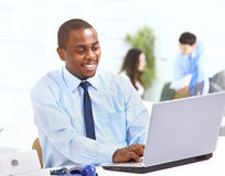 Displaying computer laptop in office Stock Photography