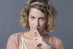 Displeased attractive young woman grumbling for too much noise Royalty Free Stock Photos