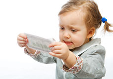 Displeased baby with banknote Royalty Free Stock Image
