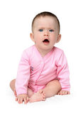 Displeased baby girl sitting Stock Photography
