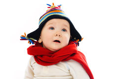 Displeased baby wearing warm winter clothes Royalty Free Stock Image