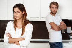 Displeased beautiful brunette girl in quarrel with her boyfriend background. Stock Images