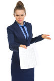 Displeased business woman with document Stock Image