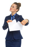 Displeased business woman tearing documents Royalty Free Stock Photo