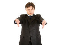 Displeased businessman showing thumbs down gesture Stock Images