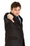 Displeased businessman showing thumbs down gesture Stock Photography