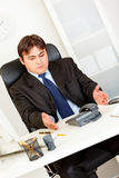 Displeased businessman waiting phone call Stock Photo