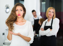 Displeased client and hairdresser stock images