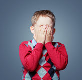 Displeased crying boy Royalty Free Stock Image