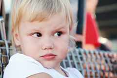 Displeased cute Caucasian blond baby girl Stock Photo