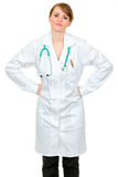 Displeased doctor woman holding hands on hips Royalty Free Stock Photography
