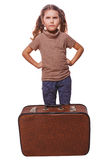Displeased evil child distraught little girl failure to travel s Royalty Free Stock Photo