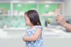 Displeased girl refuse to eat broccoli Royalty Free Stock Image
