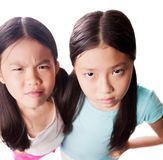 Displeased girls. Portrait of little girls staring at you with discontent Stock Photos
