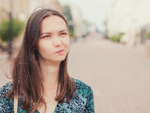 Displeased handsome young woman looking away Royalty Free Stock Images