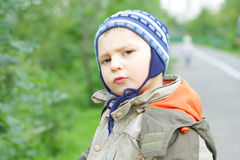 Displeased little boy Royalty Free Stock Photo
